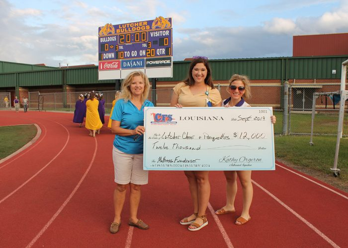 Lutcher Cheer Check for $12,000