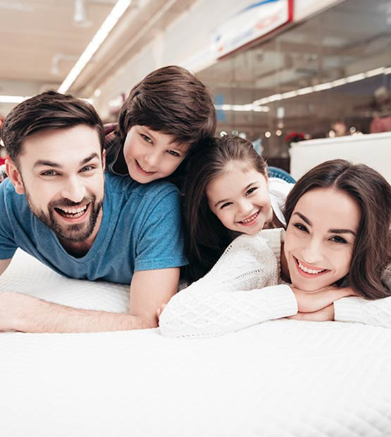 Family enjoying their new mattress